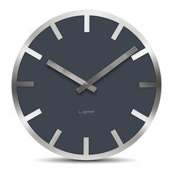 LEFF Amsterdam - Metlev35 Wall Clock - Grey Index - The ultimate melting pot; colored glass with a stainless steel edge. A clock in the most basic way, built up out of the detailed cut ring fixed to the glass. The simple index of the clock makes it look familiar yet unique. The movement holder on the back lifts the clock a bit from the wall creating an optic illusion in your room. Requires AA battery; not included.