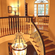 Traditional Staircase by Denis Littrell and Associates