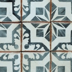 Terra Cotta Tile from Mission Stone and Tile - These hand-painted terra cotta tiles are amazing - and the company that makes them has mastered the art of the patina, making them look like they've been distressed from centuries of use. A variety of patterns and color combinations and sizes are available - good luck picking a favorite!
