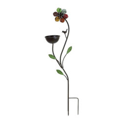 Ore International - Ore International Metal Floral Bird Feeder - 63199 - Shop for Feeders from Hayneedle.com! The Ore International Metal Floral Bird Feeder is a safe and colorful rest stop for your backyard s feathered friends. This sculptural feeder is made of quality iron in a charming flower and bird figure design. The attached bowl holds up to three pounds of seed and the dual stake base ensures a safe perch for hungry visitors.About Ore International Inc.Ore International Inc. creates beautiful accent furniture lighting and gifts for the home. Their goal is to be the leading provider of innovative superior home products worldwide. Ore International is based in Santa Fe Springs California and has a Customer First attitude. Their products are designed to match modern and classic tastes and fit today's homes. From room dividers to lamps end tables to entertainment centers you'll discover quality craftsmanship at a fair price in all Ore International products.