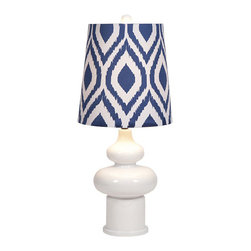 Tear Drops Table Lamp - Placed on a side table beside your comfy couch or kept beside your bed, the Tear Drops Table Lamp will refresh your space with simple, modern light. With a smoothly curved ceramic base and an artful ikat-inspired shade, this light will keep your days soft and bright.