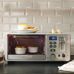 Frontgate - Waring Digital Toaster Oven with Toaster - 1,500-watt oven heats up to 450°F. Integrated 2-slice toaster features a specialized bagel setting. 30-minute timer ensures your food is cooked to perfection. Includes easy-to-clean baking pan and drip tray. Brushed stainless steel front panel. Bake, broil, toast and reheat with this convenient, space-saving toaster oven/toaster. Featuring an easy-to-read digital LED display, this 1,500-watt oven has an integrated two-slice toaster with a specialized bagel setting. 1,500-watt oven heats up to 450 degreesF. . . . . 3-1/2 ft. cord. 120V.