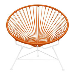 Buena Vista Chair in Orange - Using modern day materials and a traditional Mayan weaving technique, the hoop shaped Buena Vista chair is perfect for indoor and outdoor use. Its woven vinyl cords not only offers a clean aesthetic, but is a comfortable place to relax. Use as an accent piece or pair with more than one to create a shared space for guests.