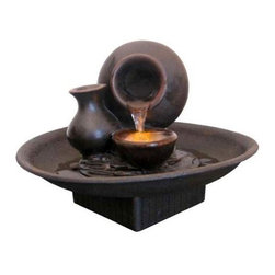 Welland - Welland Pot Pouring Water Tabletop Fountain with LED Light - This tabletop fountain features a vessel pouring water into a lighted basin with a second dry vessel at its side. Features an illuminated lotus flower with emanating water. Includes an LED light and pump. Tabletop fountain capture the essence of form, function, and beauty all in one! Finish color may vary from picture. Suitable for home decoration. Can be put on nightstand, bookshelf, coffee table or any shelf. For indoor or outdoor use.