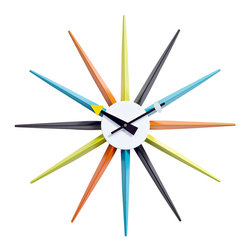 LexMod - Sunburst Clock - Travel on timeless rays of light with this classic from the 1950s. Relive the modernist's passage from conformity to expression with Sunburst's twelve multi-colored metal shafts. Every era has its future built into it. Synergize your ambitions with lessons of free spirit and inspiration from the previous generation.