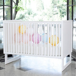 """Nurseryworks - Loom Crib - This Shaker-inspired crib is offered with one figured-end design and three slat types: low-VOC lacquer in Snow, natural catalpa, and dark catalpa. Features of this crib include a fixed side rail, standard full-size crib dimensions, and three-point adjustable mattress height. Designed by Truck Product Architecture for Nurseryworks NOTE: Toddler / Daybed Conversion Kit must be in the same color option as the Loom Crib Features: -Available with Toddler Bed / Daybed Conversion Kit -Slats available in Snow White, Dark Catalpa Wood or Natural Catalpa Wood finish -Ends in lacquered Snow White -Non-toxic lacquer and veneers -Fixed side rail -Standard full size crib dimensions -Three point adjustable mattress height -Converts to toddler daybed with guardrail -JPMA Certified -Overall Dimensions: 39.5""""H x 53.5""""W x 31""""D Complete Your Loom Crib with Bedding from Nurseryworks This Crib is approved for use in the United States. This is a NON-Drop Side crib"""