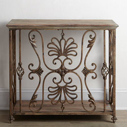 "Horchow - Astrella Console - An ornate ""cage"" of scrolled and twisted ironwork turns this console into a work of art. It makes a dramatic addition to an entry or hallway and adds intrigue to any living space. Made of iron and wood. Distressed gray and golden antiqued finish. 40""..."