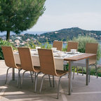 Samba Collection of Teak Outdoor Dining Furniture - The Samba Collections features a teak outdoor dining table and high back wicker dining chairs.