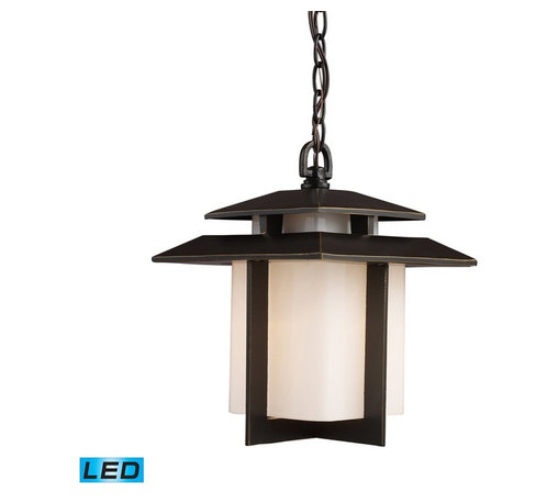 "Elk Lighting - Elk Lighting Kanso Outdoor Pendant Light with Hazlenut Bronze X-DEL-1/27124 - ""Embracing The Everyday, Unadorned Things In Life Is To Embrace Truth"".  Rarely Has Any One Philosophy Had Such A Clear And Defined Impact On A Garden Style As The Indelible Mark Left By Zen On The Japanese Garden.  Kanso Is One Of The Six Basic Aesthetic Principals Embraced By Zen.  Simplistic Styling, A Key Tenet Of Zen, And Cleanliness Of Form Is A Repeated Motif In Japanese Architecture.  Constructed Of Cast Aluminum, This Series Features An Aged Bronze Finish With Contrasting White Glass.   - LED Offering Up To 800 Lumens (60 Watt Equivalent) With Full Range Dimming. Includes An Easily Replaceable LED Bulb (120V)."