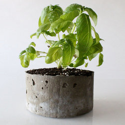 Cast Stone Planter, Basil - Cast stone planters look wild and natural and would be great dispersed among landscaping.