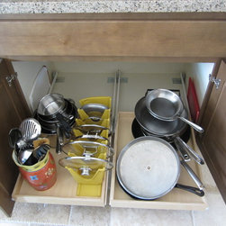 Under cabinet pull out shelves by slideoutshelvesllc.com - Organizers under the cabinet are easier to access with slide out shelves from slideoutshelvesllc.com