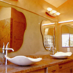 Residence -  Custom vanity mirrors - We designed these mirrors to compliment the shapes of the wash basins. Additionally, we mounted the mirrors to the wall color matching, back-painted glass background to add a reflection on reflection effect. Location: Santa Rosa, CA. Photo by Robert Tutone
