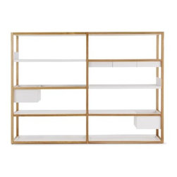 """Case - Lap Shelving Medium Frame - Marina Bautier's Lap Shelving System (2010) takes storage in a refreshingly new direction, giving you a modular solution that you can customize to suit your needs. Like many of us, Bautier realized the redundancy in storing objects in a box or on a tray that is then placed on a shelf. Instead, her solution eliminates the shelf where it's not needed; and replaces it with a powder-coated sheet metal box or tray that hangs from the solid oak frame. (The name """"Lap"""" refers to how the metal overlaps the wood structure.) These metal storage components include a Deep Box, Shallow Box, Tray Shelf, Bookshelf (U-shaped to keep books in place) and Flat Shelf. How you arrange the components is up to you, and they can be rearranged at any time. To expand the solid oak frame widthwise, simply add any number of Extension Units. Ships flat; simple assembly required. Made in Lithuania. DWR Exclusive"""
