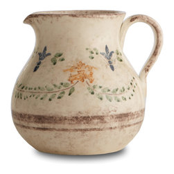 Arte Italica - Medici Pitcher - Giglio — the Italian version of fleur-de-lis — takes on rustic charm to adorn this graceful pitcher. Handmade in Italy, its simple pattern and subtle colors make it a timeless addition to your table.