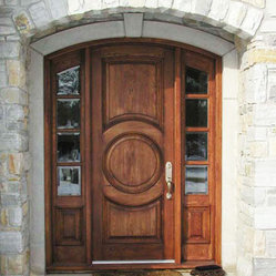 Harvest Creek Millwork Solid Wood Door - I love how substantial the this carved wood door is. The entire package is perfectly framed by the architecture.