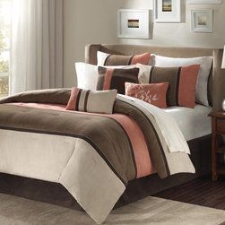 "Madison Park - Palisades Comforter Set - Palisades offers you a casual alternative in fashion bedding. The reverse of the comforter is solid coral. The soft microsuede in khaki, brown and warm coral is pieced together to create this beautiful bed set. The decorative pillows are embroidered and pieced to add a decorative element. Features: -Set includes 1 comforter, 2 king shams, 1 bedskirt and 3 decorative pillows. -Color: Coral / natural. -Material: Polyester microsuede. -Poly filling. -Pieced microsuede. -Dimensions: 90""-104"" Height x 90""-92"" Width."
