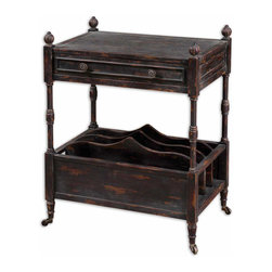 Uttermost - Phineas Black Distressed Magazine Table - Hand  distressed  wood  magazine  rack  with  rolling  casters.  The  Phineas  style  table  is  painted  black  and  then  the  edges  are  rubbed  to  reveal  the  natural  wood  underneath.  Lower  shelf  includes  four  vertical  slots  to  hold  magazines  or  books.  Upper  shelf  includes  a  drawer.  Assembly  required.