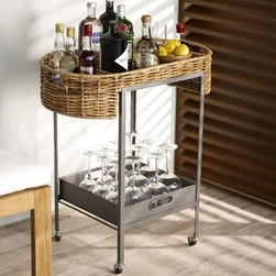 Woven Bar Cart - We love the juxtaposition of industrial style and wicker in this woven bar cart. Stylish and sturdy, it's the perfect size for tucking into a patio corner.