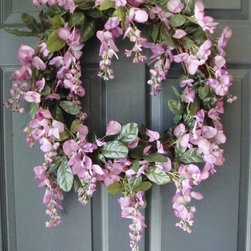 Wisteria Wreath from HomeHearthGarden - An elegant & luxurious summer wreath like no other for your front door or as a wall decor. The wreath is handmade with natural-looking faux wisteria and green foliage on a grapevine base. Give your family and quests the warmest invitation to your home with this Wisteria Door Wreath.