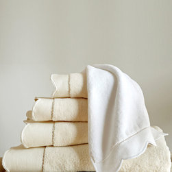 Overature Towel - Cloud-soft terry is a treat for after the bath, while the polished scallop edge of each Overture Towel makes display an elegant proposition.  Cultivated choices for the high-end designer bathroom, these towels are made from 600-gram cotton velour; their hemstitch border is a simplified, pared-down version of a lace cuff that might have featured on traditional linens.