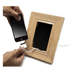 J-Me - Frame Mobile Phone Holder - When your mobile phone is recharging inside this fantastic frame, your device looks, well, as pretty as a picture. Seeing the phone propped up in the clever charging station like a cherished photo is worth a thousand words.