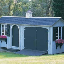 """8' x 20' Tool and Storage Building - One of our most popular models, The garage side is ideal for storing your tractor. The other side for everything else. This 8' x 20' building comes with Board and Batten siding, a 3' Arched Dutch door with night lock and latch, 2 double casement windows with shutters and window boxes, one 8' double door with ramp, one 3' step, center partition to peak, 20"""" Brittany cupola. Special body stain and white trim."""