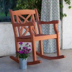 Magnolia Rocking Chair - Enjoy the warm, summer days outdoors with a cold drink and a great book while rocking in the Coral Coast Magnolia Rocking Chair. Beautifully designed with a decorative back and contoured seat, this chair is crated from naturally rot-, insect-, and weather-resistant acacia wood. Its natural finish easily blends in with any decor, whether on your deck, patio, or front porch.About Coral Coast What if, when you closed your eyes, you pictured yourself in your own backyard? Coral Coast has a collection of easygoing, affordable outdoor accessories for your patio, pool, or backyard. The latest colors and styles mingle with true classics in weather-worthy fabrics and finished woods, ready for relaxation. Make yours a life of leisure.