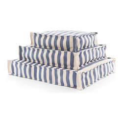 Trimaran Stripe Denim/Ivory Indoor/Outdoor Wouf - This soft, structured fabric accessory is not a pouf, but a Wouf � a rectangular pet bed with neat turned-out edges that's designed to suit the look of an elegant home.  The Trimaran Stripe Indoor/Outdoor Wouf from the Fresh American line of soft furnishings features stripes of handsome, rustic denim blue alternated with ivory to yield a glamorous but versatile variation on the maritime stripe.