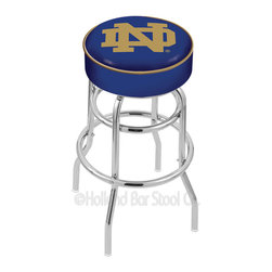 "Holland Bar Stool - Holland Bar Stool L7C1 - 4 Inch Notre Dame (Nd) Cushion Seat - L7C1 - 4 Inch Notre Dame (Nd) Cushion Seat w/ Double-Ring Chrome Base Swivel Bar Stool belongs to College Collection by Holland Bar Stool Made for the ultimate sports fan, impress your buddies with this knockout from Holland Bar Stool. This L7C1 retro style logo stool has a 4"" cushion with a tough double-ring base and a chrome finish. Holland Bar Stool uses a detailed screen print process that applies specially formulated epoxy-vinyl ink in numerous stages to produce a sharp, crisp, clear image of your desired logo. You can't find a higher quality logo stool on the market. The structure is triple chrome-plated to ensure a rich, polished finish that will last ages. If you're going to finish your bar or game room, do it right- with a Holland Bar Stool. Barstool (1)"