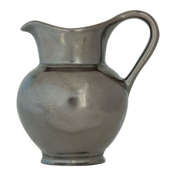 Pewter Stoneware Creamer - In the style of dinnerware that graces European country cottages, the Pewter Stoneware Creamer boasts an unadorned, timeless design that is simply charming. Perfectly sized to hold fresh cream for coffee or tea, a splash of syrup for morning cr�pes, or a drizzle of caramel for a dessert custard. The elegantly elongated handle allows for ease in pouring.