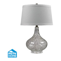 Clear Water Glass HGTV Table Lamp With White Linen Shade 174 - The Design experts at HGTV and the lighting specialists at ELK Lighting have teamed up to create perfectly stylish floor and table lamp lamps that will bring a designer edge and illumination to every room in your home. Take home what you love about the HGTV Network: Insider Knowledge and stylish product solutions for the lifestyle of today. Clear Water Glass Table Lamp With White Linen Shade