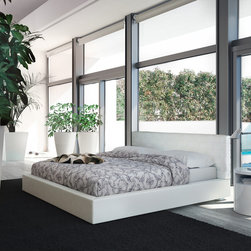 Madison White Eco-Leather Platform Bed - Madison platform bed is an exceptional bed that is made with eco leather in white color. Available in Queen, California King and Eastern King sizes.