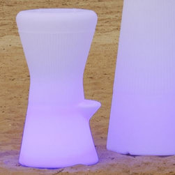 Artkalia - Biarritz LED Stool by Artkalia - Part stool, part lamp, completely cool. The Artkalia Biarritz LED Stool is molded out of of sturdy, shock- and water-resistant polyethylene. This strong material is also the ideal diffuser for the internal RGB LED module. The various light colors and effects will definitely add some excitement to your outdoor parties. Artkalia was founded in 2008 to combine energy efficient LED technology with attractive modern design. In order to make such design and efficiency accessible to as many people as possible, they have made their portable LED lighting affordable, fun and easy to use. Artkalia lighting designs enhance moods and indoor and outdoor spaces with their friendly, contemporary forms as well as their signature light color-changing technology.