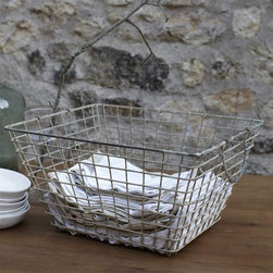 Vintage Oyster Basket - These open wire baskets are among my favorites for storage and display. Why keep your beautiful everyday linens hidden in a drawer?