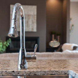 6513 Hitching Post - Brodie Single-Hole faucet features a pull-down spray head that lets you switch from stream to spray.