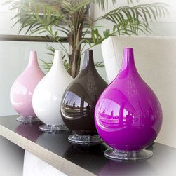 Frontgate - Broksonic Hybrid Ultrasonic Humidifier & Diffuser - Ideal for small rooms up to 300 sq. ft.. Easy-to-fill removable water tank. Different colors indicate cool mist output settings. Automatic shut-off protection for empty tanks. Simple-to-use aroma trays; tester size of lavender essential oil included. Enhance both the humidity and decor of your room with the Hybrid Ultrasonic Humidifier and Diffuser. Available in a several stylish colors, it has an 84 oz. capacity and runs for 19 hours before requiring a refill. By adding essential oils to the built-in aroma trays, you can transform your humidifier into a easy-to-use fragrance dispenser.. . . . . No filters required. Run time: Approximately 19 hours. Tank capacity: 84 oz.. Timer settings for 2 and 4 hours. Quiet operation. To clean, add undiluted clear vinegar, let stand for 20 minutes, drain, rinse with water, drain water, and wipe clean. View instructions for use. 6' cord length. 1-year manufacturer's warranty.