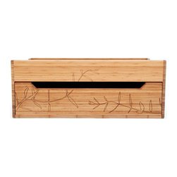 """Kalon Studios - Kalon Studios Trunk with Honeysuckle Engraving - Kalon Studios designs nursery furniture with a focus on contemporary form, innovative style and sustainability. A versatile and modern furnishing, this spacious trunk adapts from a changing table to a toy chest or reading bench as a child grows. Decorated with honeysuckle floral engravings, the low profile hardwood piece fits atop a dresser or rests on the floor. Its knobless, sliding drawer conveniently stores diapers, clothing, toys and books. Made in the USA from FSC certified bamboo or a maple wood upgrade with a non-toxic finish. Some assembly required. 34.25""""W x 17.75""""D x 13""""H. Fits standard and contoured changing pad (not included). Not intended for children over 50 lbs. Glue contains zero formaldehyde and exceeds European E1 and California emission standards by 3 times."""