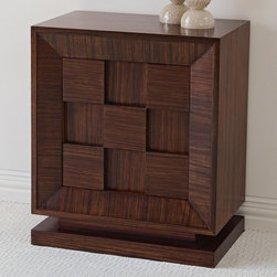 Global Views - Small Block Nightstand Multicolor - 2260 - Shop for Nightstands from Hayneedle.com! Compact in size but bold in style the Small Block Nightstand offers handy storage for any room in your home. As a nightstand in your bedroom or an end table in the living room this dramatic chest features one door on the front and one adjustable shelf inside. It's constructed of birch hardwood and durable MDF for long-lasting strength and beauty. The wood is finished in a dark walnut stain with lacquer and a hand-rubbed wax finish applied over zebra wood veneers which results in a rich vertical and horizontal grain pattern on each block and the single door frame.The shelf and interior are fully veneered to provide smooth surfaces to protect personal items stored inside. A simple finger pull opens the door and maintains the pure wood appearance of the piece. The modest size and scale of this contemporary chest offers great flexibility making it suitable for any room in your home.Delivery Notice: This item includes White Glove Freight Delivery to the room of your choice including up to two flights of stairs. The product is unpacked debris is removed and basic setup without tools is included. Full assembly service typically involves additional charges payable prior to delivery. Special service arrangements may be made directly with the freight carrier when they call you for your delivery appointment.About Global ViewsGlobal Views is a provider of quality fashion-driven home furnishings and accents from around the world. Their products range from decorative accents like candelabras and lighting fixtures to benches chairs and tables. High-end home decor magazines such as Elle Decor Metropolitan and Traditional Home have taken notice of the quality and style their products exhibit. Global Views products have also been featured on main-stream TV show sets including Extreme Makeover Home Edition HBO Golden Globe SAG party and the Apprentice.Always environmentally aware all Glo