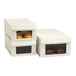 Drop-Front Canvas Shoe Boxes - These canvas shoe storage boxes leave a window so there's no need to add an image of your shoes to the front of the box. They also fight mold in the more humid parts of the world that plastic boxes can't.