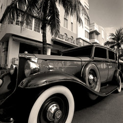 The Andy Moine Company LLC - 1932 Packard 443 Limo Park Central Hotel Miami Florida Black & White Photography - Black and White Fine Art Photography captured with 35MM Ilford Film and reproduced in Limited Editions on Brushed Aluminum. This is a beautiful composition of a 1932 Packard 443 Limosine with the Art Deco inspired Park Central Hotel in South Beach Miami Florida in the Background.