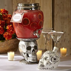 """Skull Metal Beverage Drink Dispenser Stand - Our disembodied skull makes even the sweetest drinks seem a little sinister. 7.25"""" wide x 8.25"""" deep x 7.25"""" high Made of cast aluminum with an antiqued finish. Catalog / Internet only."""