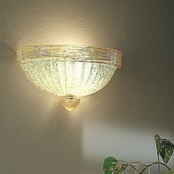 """Vistosi - Vistosi Romanza wall sconce (wide) - The Romanza wide wall sconce by Vistosi has been designed by Studio Tecnico Vetreria Vistosi 2002. This crystal blown design is made in """"piastra"""" glass with """"granglia"""" textured surface decoration. It is made in """"rigadin"""" style, detail accented in 24K gold specks. This design radiates a glow of light and is sized so it can be paired on sides of a focal point, if desired. It is offered in two wattage choices for your illumination preference. This beautiful light was hand crafted on the island of Murano. Each light comes with a certificate of authenticity.  Product Description: The Romanza wide wall sconce by Vistosi has been designed by Studio Tecnico Vetreria Vistosi 2002. This crystal blown design is made in """"piastra"""" glass with """"granglia"""" textured surface decoration. It is made in """"rigadin"""" style, detail accented in 24K gold specks. This design radiates a glow of light and is sized so it can be paired on sides of a focal point, if desired. It is offered in two wattage choices for your illumination preference. This beautiful light was hand crafted on the island of Murano. Each light comes with a certificate of authenticity. Details:                          Manufacturer:             Vistosi                            Designer:                         Studio Tecnico Vetreria Vistosi 2002                                         Made in:            Italy                            Dimensions:                         width: 11.8"""" ( 30 cm) x height: 5.9"""" ( 15 cm) projection: 5.9"""" ( 15 cm)                                         Light bulb:                         1 x 100W Incandescent, 1 x 23W Fluroscent                                         Material:             crystal, 24K gold specks, gold plated metal"""