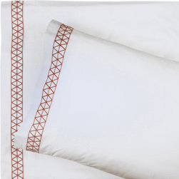 Jonathan Adler Orange Mustique Sheet Set in Orange Mustique - I love the touch of exotic embroidery on the edges of this sheet set. Pair it with the Orange Mustique duvet cover or use it with another pattern on your bedscape.