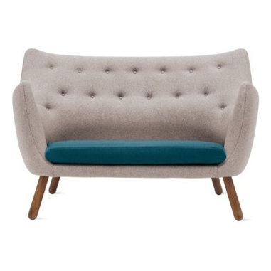Onecollection - Poet Sofa - The sofa is usually the main place to sit, but a smaller sofa like this one encourages people to spread out and sit on chairs as well. The bonus to this is that chairs are more easily moved to face one another and encourage better conversations.