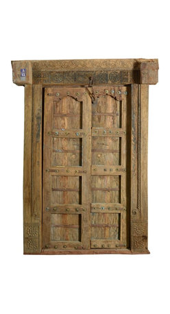 Sierra Living Concepts - Camelot Gothic Hand Carved Solid Teak Double Doors & Frame - Make your home legendary with the Camelot Gothic Double Doors and Frame Set. This antique style entryway ensemble is built with solid teak wood, a premium wood famous for its longevity and strength. The fine wood grain showcases the detailed carving on the lentil and door frame. The surfaces are seasoned naturally over time, no modern stains or paints are added.