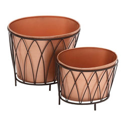 "Benzara - Exclusive Styled Metal Oval Planter - Introducing this classy styled metal oval planter that will add style to your room space. This fancy metal oval planter is made of quality metal and thus durable. This metal oval planter features brown finish with metal designed exteriors. You can bring home a farming theme. If you are a nature lover then this metal oval planter surely going to fascinate you. You can add this exclusive metal oval planter to your showcase, bare space, on a plain table top else a place of your choice.This Metal oval Planter will make you win appreciations from many. Besides, you can also gift this exclusive Metal oval Planter to your near and dear ones. Put an end to your thoughts and get this Metal oval Planter right away. It is worth owning. Did you get one?. Metal Oval Planter measures 30 inches (Width) x 10 inches (D) x 9 inches (Height) ; Made of quality wood; Durable construction; Dimensions: 24""L x 24""W x 18""H"