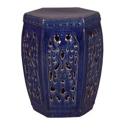 Kathy Kuo Home - Hexagon Pierced Ceramic Garden Stool- Navy Blue Glaze - Traditionally used in China as tea tables-these garden stools make a perfect addition to your living space as side tables, or clustered together to be used as a coffee table. Glazes are triple fired for added luster and shine. With a hand made product, glaze variations of up to 10% is to be expected.