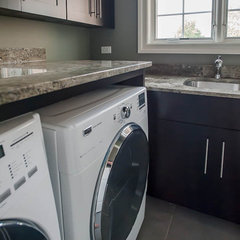 contemporary laundry room by Summit Signature Homes, Inc.