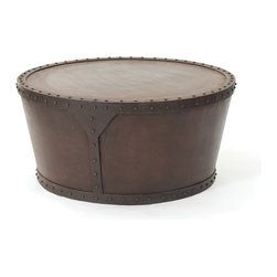 Go Home - Tambour Drum Table - Park this intriguing piece in front of a sofa or sectional to get the conversation started! This sturdy, drum-inspired table is fashioned from iron with a vintage rust finish and eye-catching, studded detail. Pair with other items from our Urban Loft, Rural Chic or Mountain Lodge Furniture Collections to infuse your home with good taste..indeed!