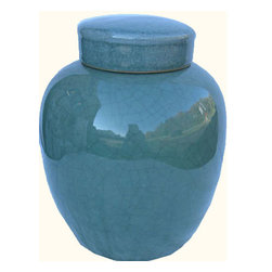 "n/a - Chinese Porcelain Radish Jar With Celadon Glaze - Our elegant Chinese porcelain radish jar with a removable lid features an eye catching Celadon green glaze. Almost jade like in appearance, this traditional Chinese porcelain  is ideal for your cottage, colonial or modern interior. A wonderful storage container or decorative accent. We recommend this for table top use. Use a pair juxtaposed for an interesting vignette. Consider one of our 7"" flat rosewood stands for display, or we can make it into a lamp."